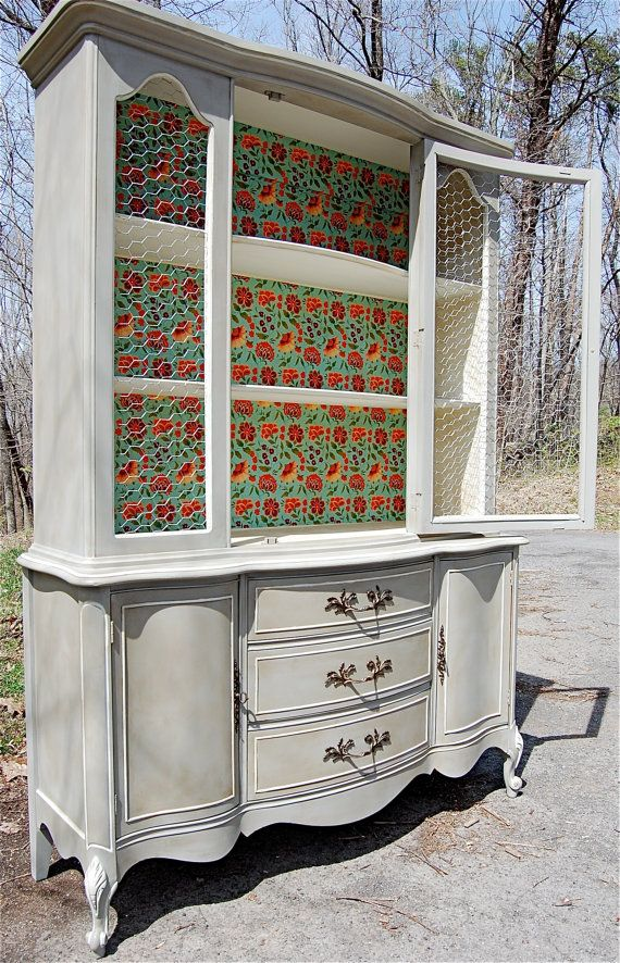 French provincial hand painted china cabinet hutch with chicken wire and a decorative decoupaged interior