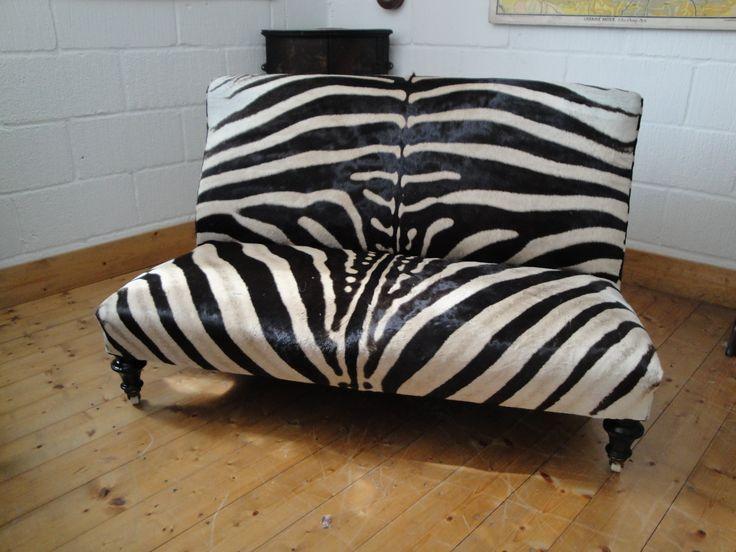Zebra skin sofa...I would love one or two.