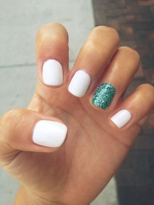 white + green glitter accent nails.