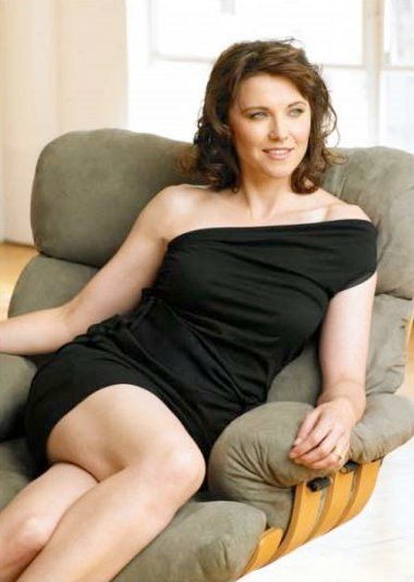 Lucy Lawless - LBD and brunette wavy lob...if I had a dollar for.every time I've been told I resemble her!