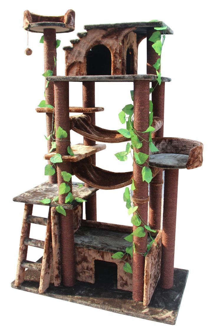 You can see the tree which this tree house castle clings to through - Discover Stylish Cat Furniture You And Your Feline Will Love With Cat Towers Kitty Condos Trees Houses And More