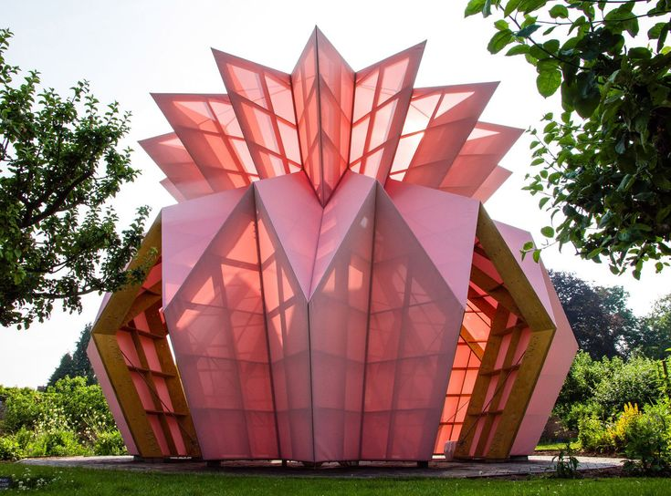 Pink pineapple pavilion pops up in English garden