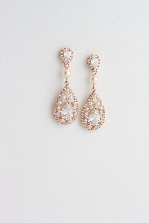 Darling long Wedding earrings featuring detailed Cubic Zirconia components in vintage settings. Ivory Swarovski pearl ccents All handmade in my