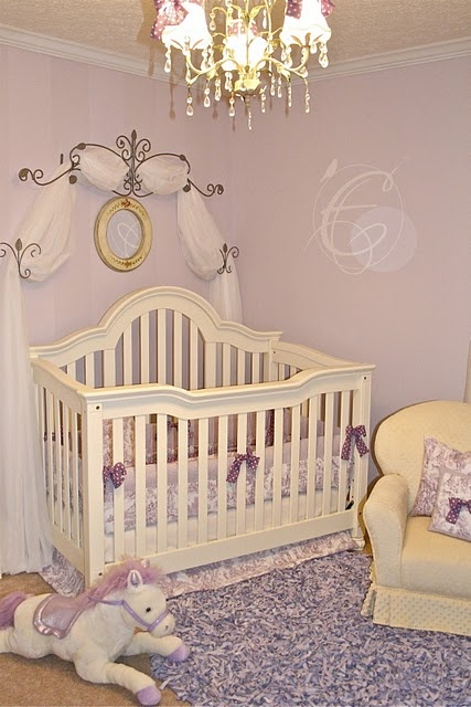 I love the idea of purple for a girls room instead of pink. I like that sash thing behind the crib. Wonder how that would translate to a twin size bed