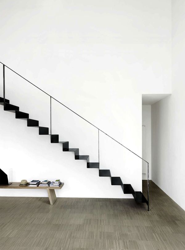 Is it black stair with white side, or just black metal stair along a white wall?  Either way, super cool.