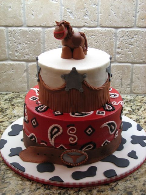 Cowboy cake - This is a cake a did for a friend's son.  He was having a horse riding party, so we went with the cowboy print theme.  This design was inspired by a couple of boween's great cakes.