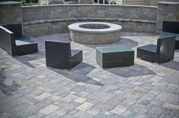 CST Fire Pit, sitting wall and patio by Artisan Exteriors of Lovettsvilel, VA.