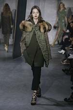 85-3.1 Phillip Lim Fall/Winter 2015/2016 Collection coat on coat, tonal variation, fur collar, suit pant with strappy heel
