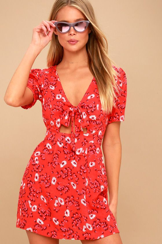 c3d64299e19f They ll be tongue tied at the sight of you wearing the Free People Jinx Red  Floral Print Tie-Front Romper! White