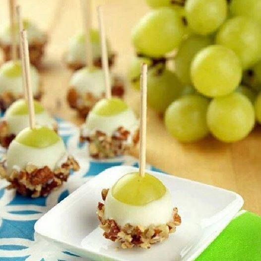 """Grape Popperz"" Snack idea! Delicious and perfect for any party! Ingredients 48 fresh grapes Vanilla Greek yogurt(or desired yogurt flavor) 1 cup chopped pecans (may substitute with any nuts) toothpicks Instructions 1. Wash grapes and pat completely dry. Spear each grape with a toothpick. 2. Holding the end of the toothpick, dip each grape in the vanilla Greek yogurt ; allow excess coating to drip off. 3. Immediately dip the end of the grape chopped pecans; place on wax paper to dry."