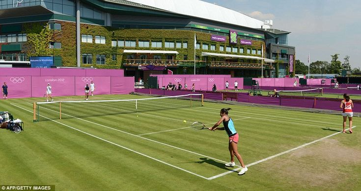 This looks different: Heather Watson (bottom) of Team GB is put through her paces as the new-look Wimbledon