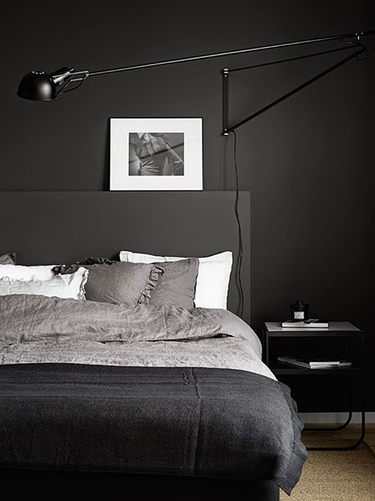The 265 wall lighting fixture from #FLOS works really well in this all black and chic bedroom.