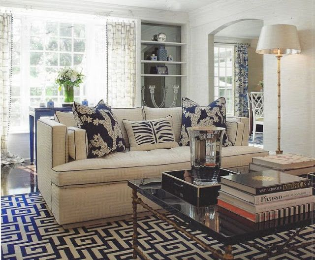 blue and white family room greek key rug coral accents coffee table
