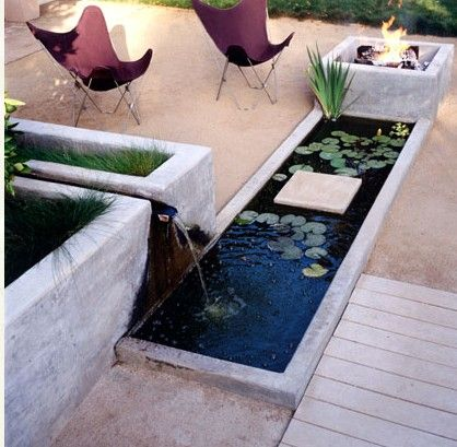 Pond fire pit small spaces first house pinterest for Contemporary koi pond design