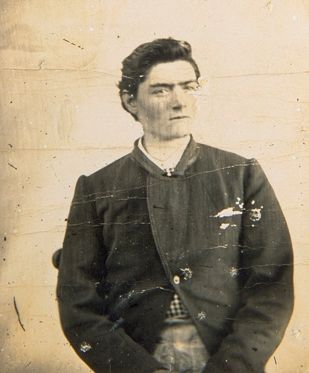Police mug shot of Ned Kelly at fifteen. 1871.