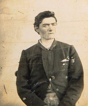 Police mug shot of Ned Kelly at fifteen. 1871.