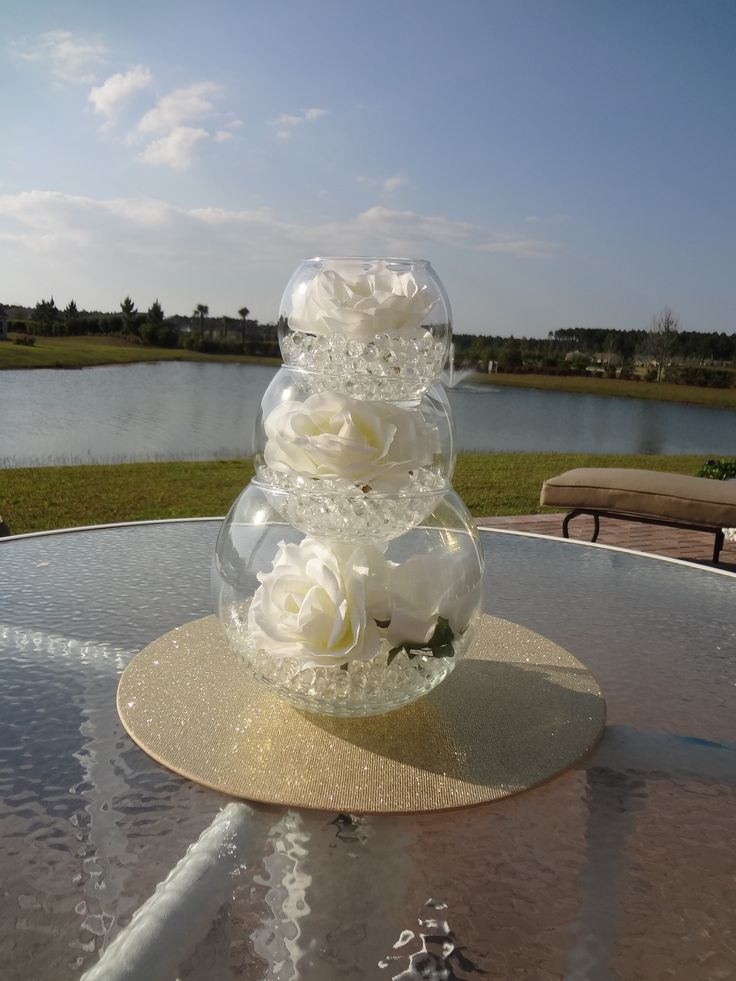 I like this centerpiece idea...you could have each level be slightly different--pearls/rhinestones, flowers, candles, etc. DIY Wedding Centerpieces | DIY Wedding Decorations - wedding centerpieces and ideas