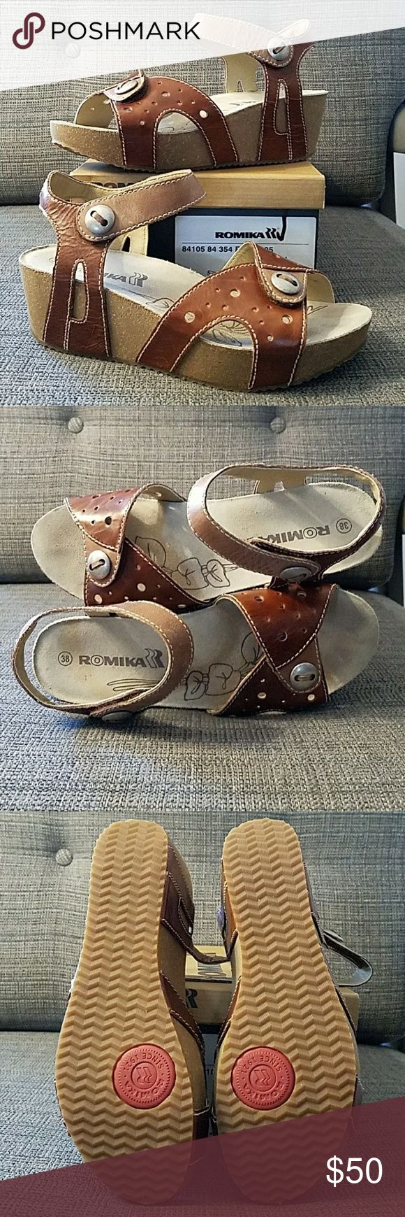 """Romika Florida 05 Womens Size 8 (38) Camel-Nut Excellent Used Condition Wore them in my house twice.  Very comfortable! Circular perforations bubble over the toe strap of a two-tone leather sandal accented with burnished buttons and a clever cork platform.  Approx. heel height: 1 1/2"""" with 1"""" platform (size 39).Adjustable strap with hook-and-loop closure.Leather upper and lining/rubber sole.By Romika imported.Women's Shoes. Romika  Shoes Platforms"""