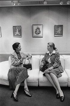 Princess Grace of Monaco chats with Anne-Aymone, wife of French president Valery Giscard d'Estaing, at the Galerie Drouant in Paris. Princess Grace is holding exhibit of her collage paintings at the gallery.1977