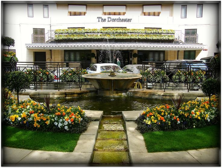 """The Dorchester Hotel in London. The gardens outside are beautiful- & there's a Chihuly """"chandelier"""" right across the street!"""