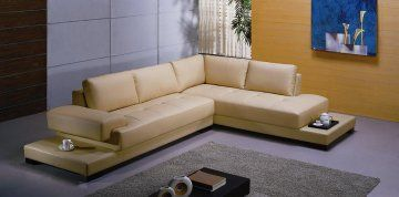 Beige Sectional Sofa Set at www.GoWFB.ca | Stylish L-shaped sectional sofa encased in quality leather covering for everyday use. This sectional sofa uses a beige-themed approach to complement neutral-toned and elaborate concepts. Modernized additions include an end table enclosed in leather to hold drinks, tufted leather design, extra padding for body and back support and real leather front cover and high quality leather match on the back. | Free Shipping #Canada