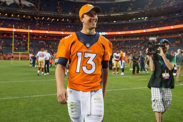 Trevor Siemian Photos Photos - Quarterback Trevor Siemian of the Denver Broncos walks off the field after a preseason NFL game against the San Francisco 49ers at Sports Authority Field at Mile High on August 20, 2016 in Denver, Colorado. - San Francisco 49ers v Denver Broncos