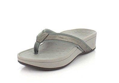 These ladies flip flop sandals with a heel feature a textile upper with a leather trim.  A molded EVA footbed & midsole will provide you with good arch support and cushioning for all-day comfort and wear.