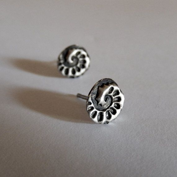 These tiny ammonite sterling silver suds are perfect for those who just like a small, unobtrusive earring, with classic style. The studs are textured and oxidized, and have a modern, minimal contemporary design.  ► DESCRIPTIONS and MEASUREMENTS: Handmade from 925 sterling silver The black area is oxidized to create contrast in the design. Then sanded to a satin, matte contrast. Measured approx. 8 x 7 mm  ABOUT AMMONITE: Ammonites are perhaps the most widely known fossil, possessing the…