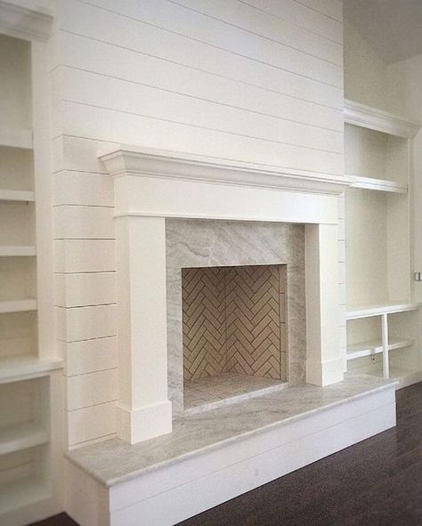 fireplace makeover with marble and shiplap