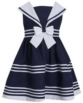 She'll be simply darling in this lovely sailor dress for toddler and little girls!  A nautical collar, classic striping and big centered bow at the waist add just the right touch of feminine sailor styling.  This girls sailor dress is great for photos, Easter or any special occasion.