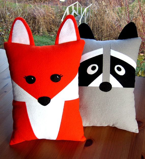 Fun DIY Fox & Raccoon Pillows PDF Sewing Pattern. Includes adorable felt fox and raccoon babies that fit into tooth fairy pocket on back or gift to a friend as an accent pillow.
