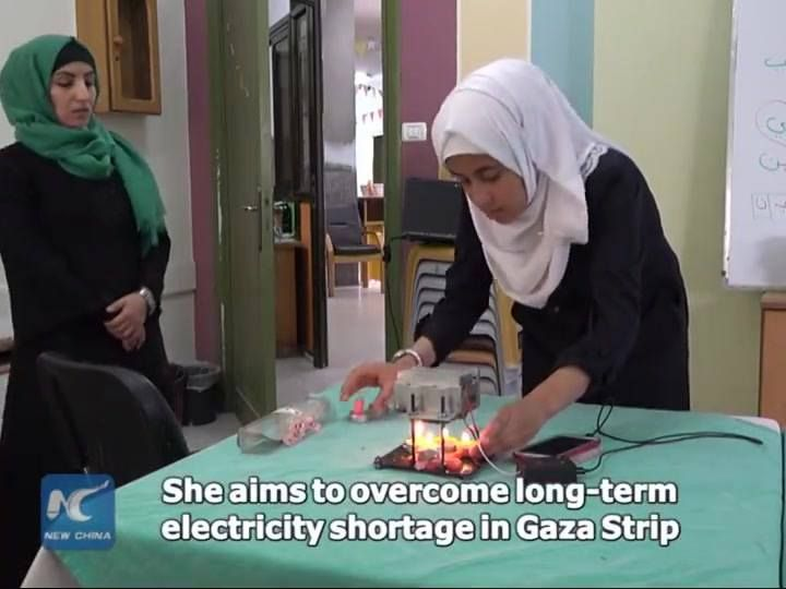 Teenage girl in Gaza uses candle heat to generate electricity, in her way to overcome chronic power shortage in the besieged enclave.