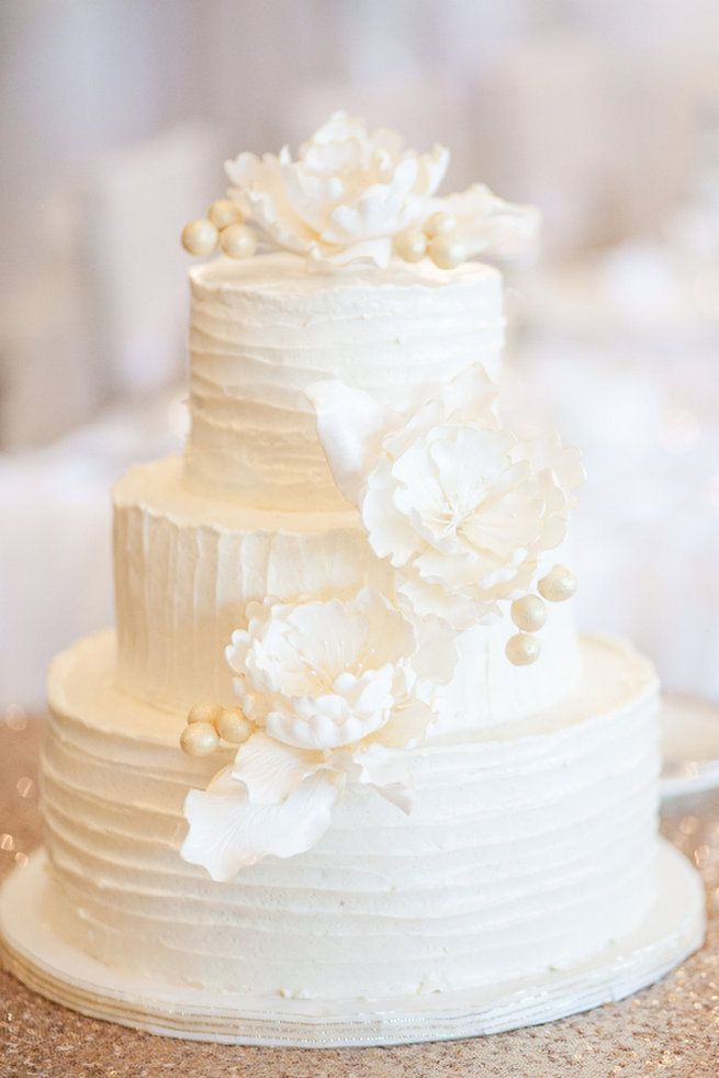 All White Wedding Cake;  This super chic and glam, this all white wedding cake with peony flowers was created by Susanna's Custom Cakes http://www.confettidaydreams.com/amazing-all-white-wedding-cakes/