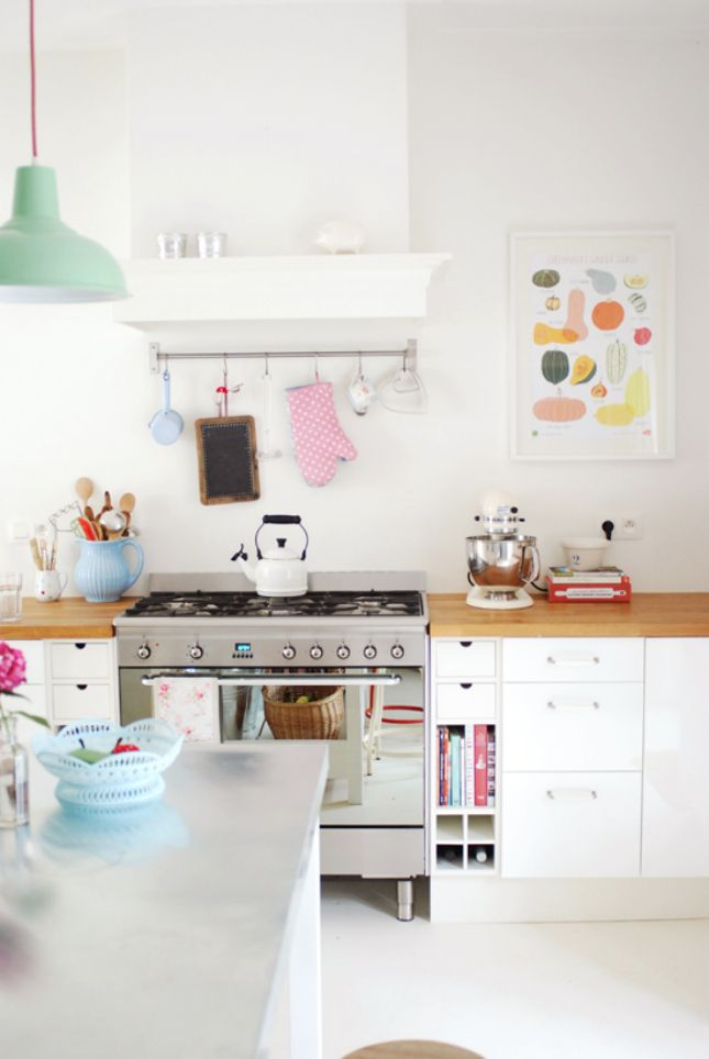 Fresh and Clean: 30 Scandinavian-Inspired Rooms via Brit + Co. Fun pastel pops of colour in this fresh white kitchen.