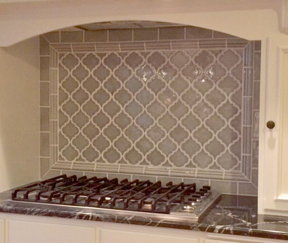 backsplash highland park dove gray 3x6 field with arabesque pattern framed in crown molding