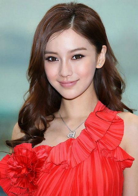 """Angelababy was born in Shanghai in 1989. Her birth name is """"Yang Ying"""". She is a famous Chinese model, actress, and singer."""