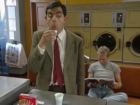 Quick Clip------Mr Bean - Getting back at a bully---Mr Bean is fed up with the bully in the launderette. He exchanges his softener with black coffee to ruin his laundry, but has to drink the softener! From Tee Off Mr Bean.