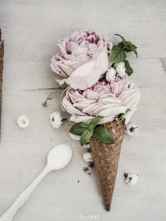 Fancy making some floral art? These rose ice cream cones are a great idea for table decorations! #Flowers #AldiFavouriteThings