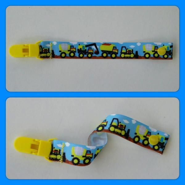 This dummy clip/saver is handmade with a durable grosgrain ribbon. Our dummy clips are a great way of keeping your bubs dummy off the floor and clean  It features a resin snap clip on one end allowing you to attach a dummy and a strong resin clip on the other which is machine stitched on several times to ensure it stays put.