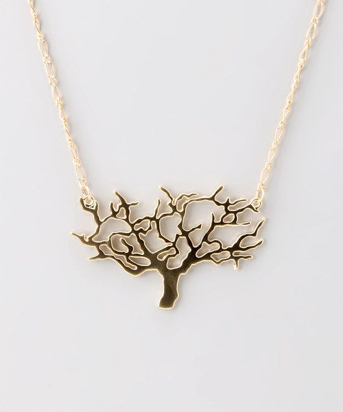Take any outfit from tame to trendy with this earthy accent. Silvery metal creates this tiny tree to add a bit of stylish shade to that sleek ensemble.16'' long2.5'' cutoutGold-plated metalImported