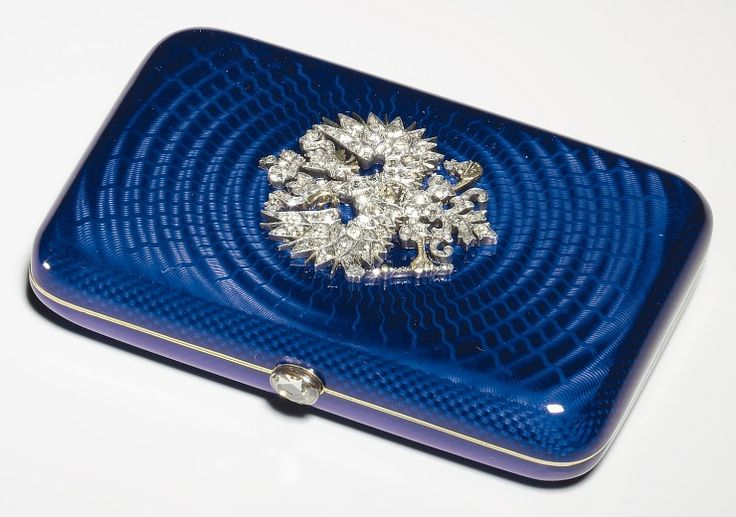 Imperial Russian Eagle Presentation Cigarette Case, workmaster Carl Blank, St. Petersburg, before 1899. Silver and gold, translucent royal blue enamel, diamonds.