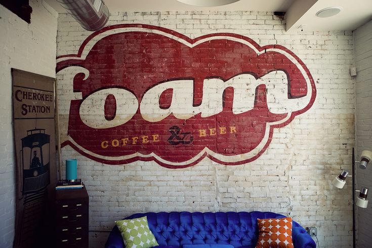 Foam coffee and beer, great concept...I really like the painted graphic on the brick wall.