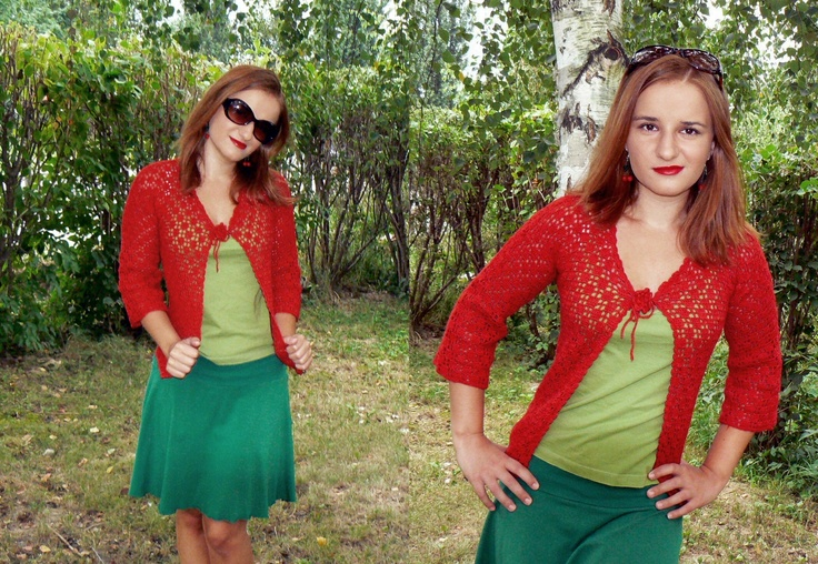 Red crochet cardigan with decorative flower.