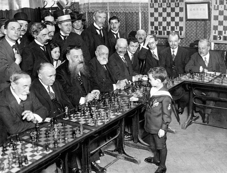 Samuel Reshevsky, age 8, defeating several chess masters at once in France, 1920. (Surely there were at least a few FEMALE chess masters back then!)