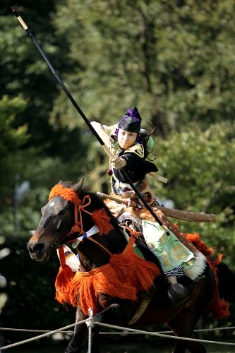 Traditional 'Yabusame' Mounted Archery in Japan. The rider drives their horse as fast as they can, then retracts their bow and attempts to shoot 3 targets in close succession. The riders were typically samurai, and the sport was ceremonially performed so the samurai could demonstrate their horsemanship and archery prowess.
