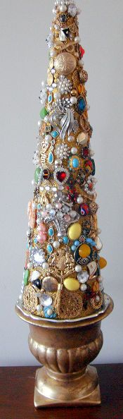 family jewelry christmas tree, christmas decorations, crafts, repurposing upcycling, seasonal holiday d cor, I used glitter glue to fill in any spaces after I had finished adding all the jewelry pieces This gave the tree a sparkly effect I placed the finish tree on a small urn pedestal