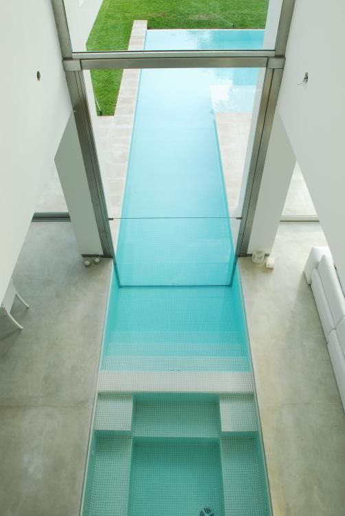 Indoor-outdoor pool inside the DMM House in Buenos Aires by Santiago Cordeyro Architects _