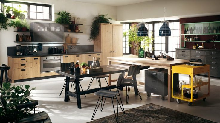 Steel is aged and the types of wood used (Ruxe Wood, Ruxe White, Ruxe Grey Knotted Oak) with the wired glass and handles, convey a time-worn...