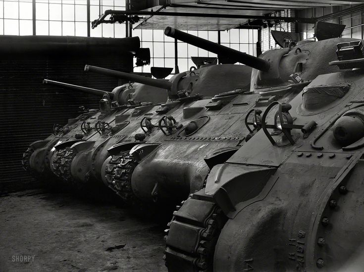 """January 1943. """"New M-4 tanks, which will soon be hurling their might against the Axis, in the Schenectady, New York, plant of the American Locomotive Company."""" Photo by Howard Hollem for the Office of War Information."""