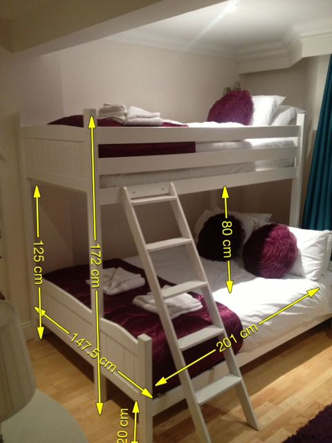 A Double bed underneath and a single on top. Ideal for holiday lets. Made